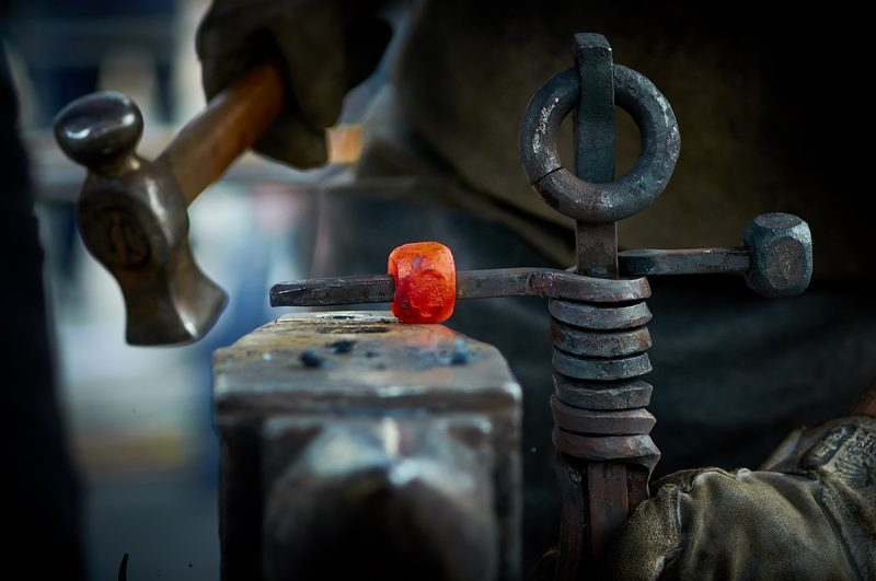 Image of a man working in iron factory